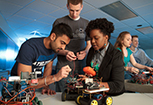 Three Penn State Abington students work together on an engineering project.