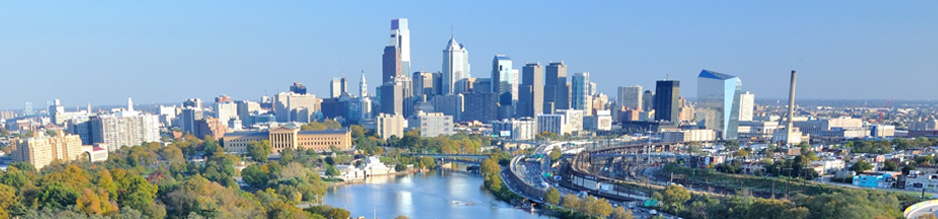 Photo of the Philadelphia skyline during the day.